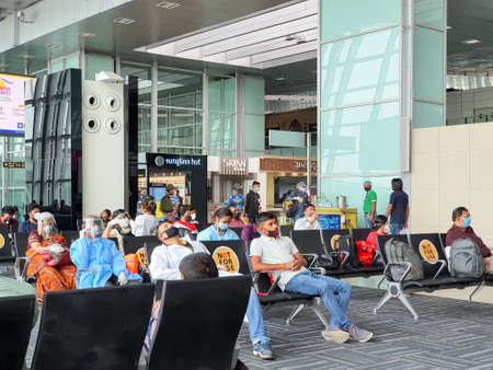 6th June 2020- Netaji Subhas Chandra Bose International Airport, Calcutta, India-Travelers maintaing social distancing in protective gear before boarding flight at airport.