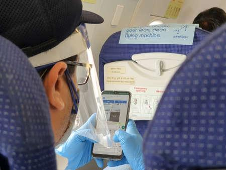 6th June 2020- Netaji Subhas Chandra Bose International Airport, Calcutta, India-Traveller in protective gear inside an indigo flight as flight services resume post lockdown In India. Editoriali