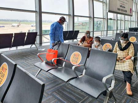 6th June 2020- Netaji Subhas Chandra Bose International Airport, Calcutta, India-Family members maintaining social distancing in protective gear before boarding flight at airport .