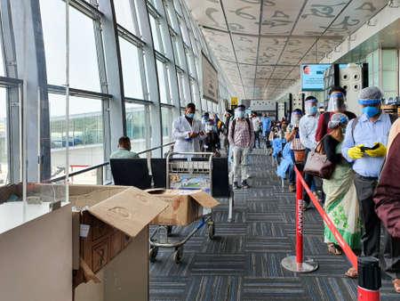 6th June 2020- Netaji Subhas Chandra Bose International Airport, Calcutta, India-Travellers boarding flights in queue maintaining social distancing at Calcutta Airport. Editoriali