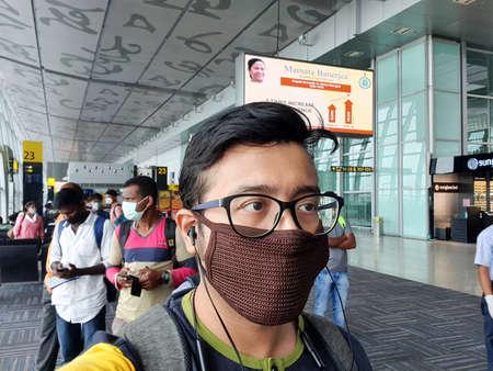 6th June 2020- Netaji Subhas Chandra Bose International Airport, Calcutta, India-Passengers with facemask and shield as flight services resume at calcutta airport post lockdown.