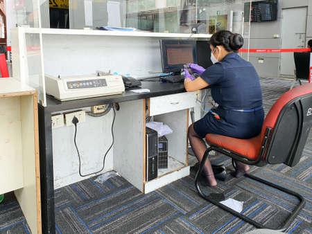 6th June 2020- Netaji Subhas Chandra Bose International Airport, Calcutta, India-Indigo flight attendant crew at her desk with limited staff working session during covid 19 pandemic.
