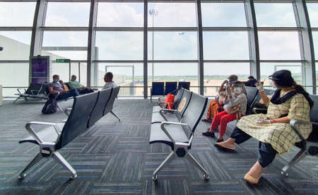 6th June 2020- Netaji Subhas Chandra Bose International Airport, Calcutta, India-Family members maintaing social distancing in protective gear before boarding flight at airport .