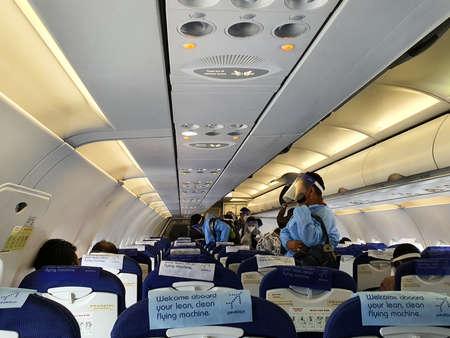 6th June 2020- Netaji Subhas Chandra Bose International Airport, Calcutta, India-passengers in protective gear inside an indigo flight as flight services resume post lockdown In India. Редакционное