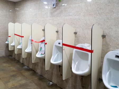 6th June 2020- Bagdogra Airport,Siliguri, West Bengal,India - Adjacent urinals blocked to maintain social distancing at Bagdogra Arport.