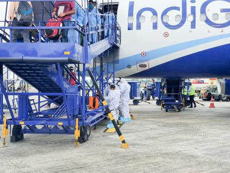 6th June 2020- Bagdogra Airport,Siliguri, West Bengal, India-Indigo airlines Cabin crew getting dressed in white protective gear at Bagdogra airport. Редакционное