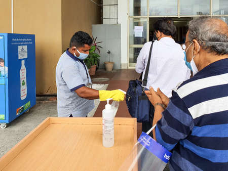 6th June 2020- Bagdogra Airport,Siliguri, West Bengal, India-Passengers in protective gear being sanitized on arrival by airport staff at Bagdogra airport.