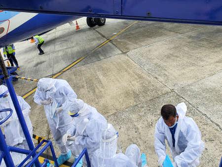 6th June 2020- Bagdogra Airport,Siliguri, West Bengal, India-Cabin crew getting dressed in white protective gear at Bagdogra airport.