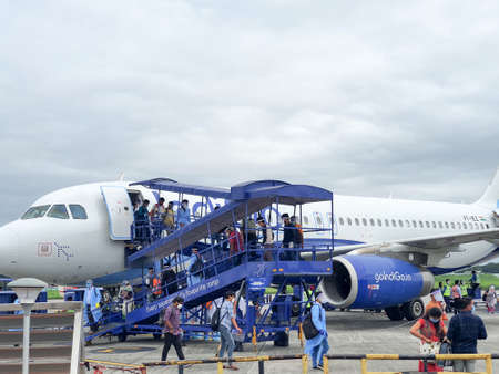 6th June 2020- Bagdogra Airport,Siliguri, West Bengal, India-Passengers in protective gear decends from flight after indigo airlines land at Bagdogra airport.