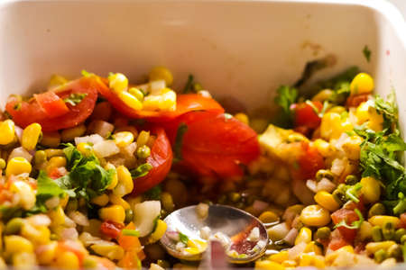 close up photo of continental vegetable corn salad in a bowl Фото со стока