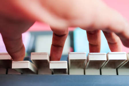 hands of musician playing piano. close up view from bottom with selective focus Фото со стока