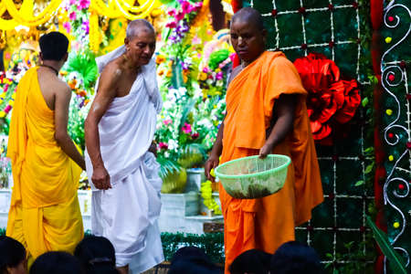 August 15th, 2020, ISKON temple, Krishnanagar, Nadia West Bengal. Monks collect offerings from devotees in a basket after evening puja at Krishna temple, Iskon.