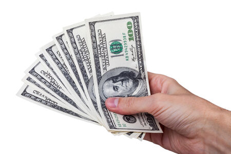Man hand with 100 dollar bills isolated on a white background.