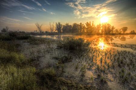 Amazingly beautiful sunrise over Lake, foggy photo