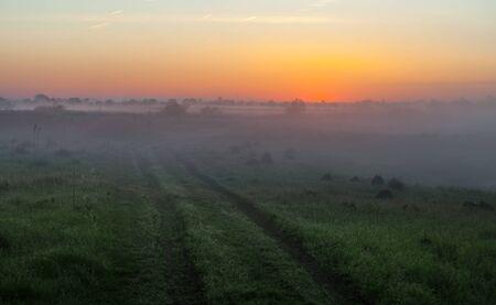 Amazingly beautiful sunrise over Lake, the foggy photo