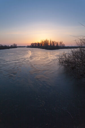 Winter landscape, dawn over the river, morning photo