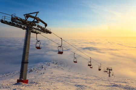 Ski lift on bright winter day, travel, cold photo