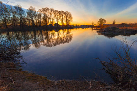 Rural summer sunrise landscape with river and dramatic colorful sky photo