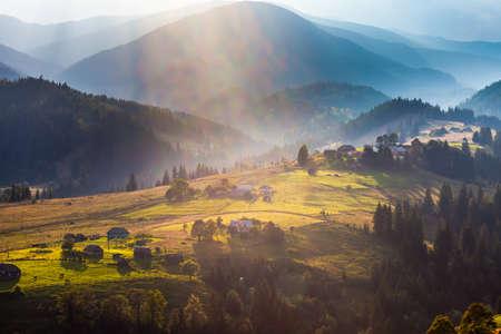 kunming: Beautiful light beam in morning with village on mountain valleys