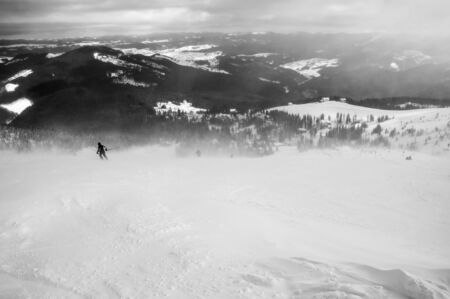 piste: Skier in mountains, prepared piste and sunny day.
