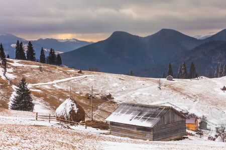 old barn in winter: Old farm in the mountains at winter.