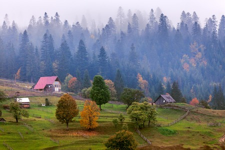 wooden hut: old wooden hut cabin in mountain at rural fall landscape. Stock Photo