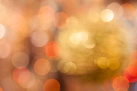 design abstract: Christmas background. Festive abstract background with bokeh defocused lights and stars.