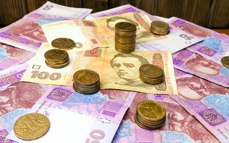 ukrainian: ukrainian hryvnia and ukrainian coins.