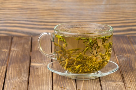 green tone: Cup with green tea.