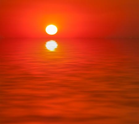 hues: sunset at sea. red color and hues of the rising sun