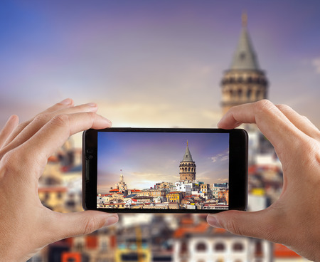 Travel concept. Hands making photo of city with smartphone camera. Istanbul. Turkey. Stock Photo