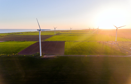 Aerial view looking across wind turbines in motion on a summers day