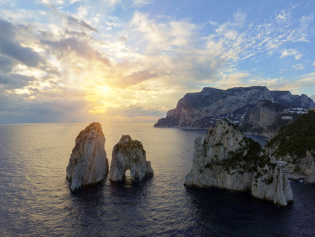 Faraglioni rocks towering up from bright blue Mediterranean waters on the island of Capri, Italy 写真素材