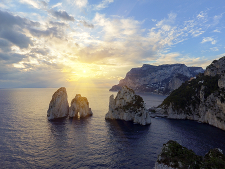 Faraglioni rocks towering up from bright blue Mediterranean waters on the island of Capri, Italy Stock fotó