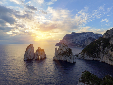 Faraglioni rocks towering up from bright blue Mediterranean waters on the island of Capri, Italy 写真素材 - 118777440