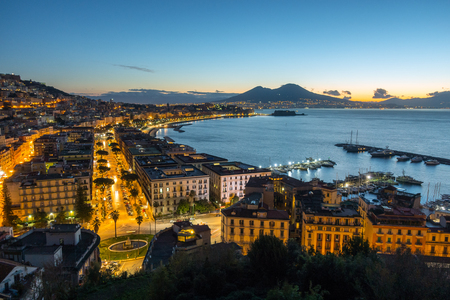 Naples, Italy. Evening city car traffic and the sea bay