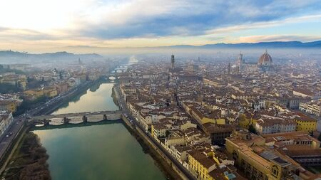 FLORENCE in Italy with the dome and Palazzo della Signoria and arno river