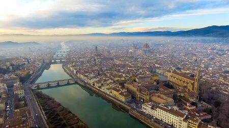 AERIAL. Panorama of the city of FLORENCE in Italy with the dome and Palazzo della Signoria and arno river