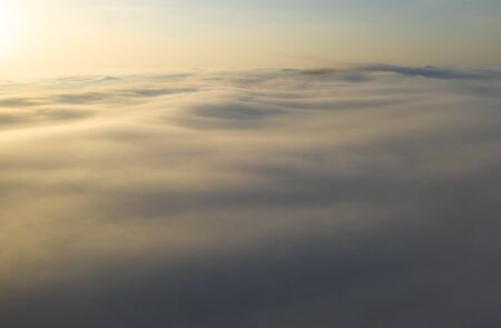 Flying over the evening clouds with the late sun.