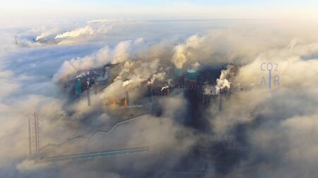 Aerial. View of high pipes with grey smoke with temperature change animation