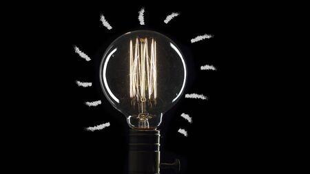 idea light bulb Flickering Tungsten light bulb lamp over black background