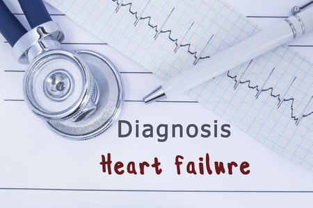 Diagnosis Heart failure. Stethoscope or phonendoscope together with type of ECG lie on medical history with title diagnosis Heart failure. Medical concept for cardiology and internal medicine Stock Photo