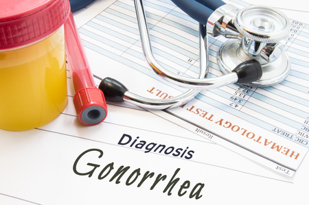 Diagnosis Gonorrhea. Stethoscope, laboratory test tube with blood, container with urine and result of blood laboratory analysis are near doctor's opinion diagnosis of Gonorrhea in medical office