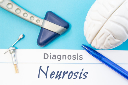 Neurological diagnosis of Neurosis. Neurological hammer, human brain figure, tools for sensitivity testing are on table next to title of text diagnosis of neurosis in the workplace of neurologist
