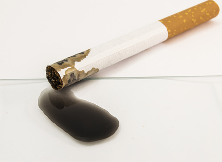 Black poison nicotine derived from tobacco cigarettes. Dangers, risk and hazards of smoking