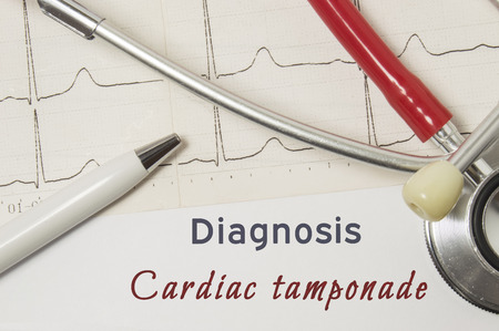 Cardiac diagnosis of Cardiac Tamponade. On doctor workplace is paper medical documentation, which indicated diagnosis of Cardiac Tamponade, surrounded by red stethoscope, ECG line and pen close-up Archivio Fotografico