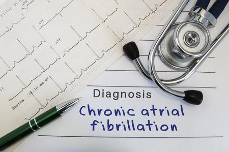Diagnosis of Chronic atrial fibrillation. Stethoscope, green pen and electrocardiogram lie on medical form with diagnosis of Chronic atrial fibrillation on the desk in the office of cardiologist Archivio Fotografico