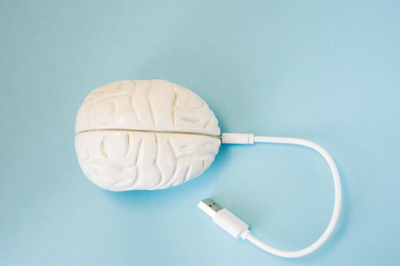 Brain with inserted in socket plug wire or charging cord. Concept technology wired transmission of data, information, knowledge in brain nervous system, mental or psychic connection or charging brain