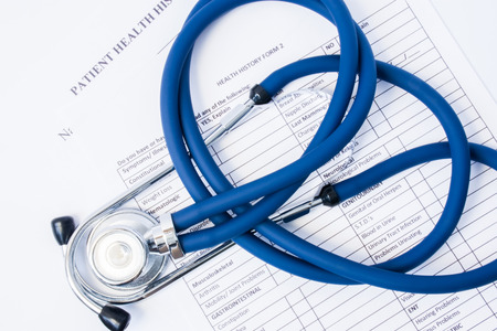 Paper form patient history and stethoscope on it. Concept of registration of patients in clinic or hospital, gathering information about disease and primary care diagnostics for preliminary diagnosis