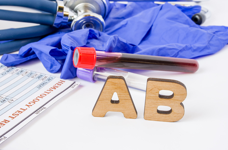 AB Clinical laboratory medical acronym or abbreviation of antibodies or immunoglobulin of immune system for neutralize pathogens. Word AB are near laboratory test tubes with blood sample, hematology